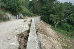 Travaux de protection de la route(construction de muret)